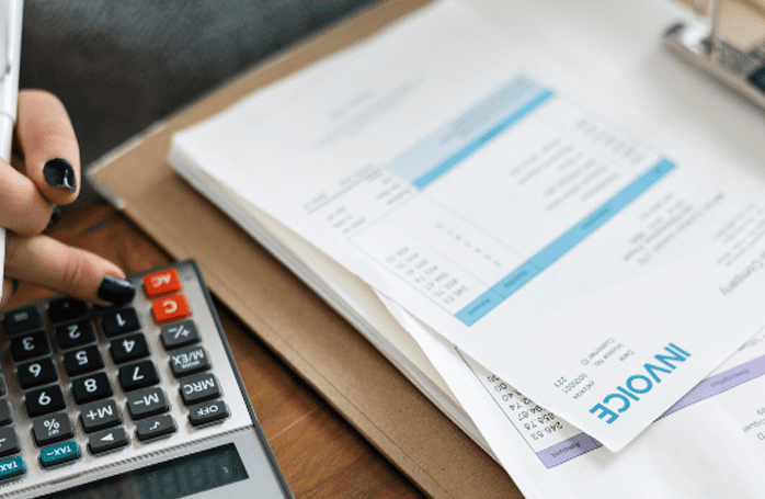invoices and calculator on desk